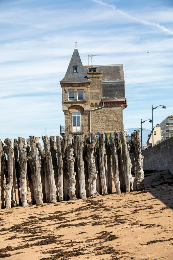 Big breakwater, 3000 trunks to defend the city from the tides, Plage de l`eventail beach in Saint-Malo,. Ille-et-Vilaine, Brittany royalty free stock image