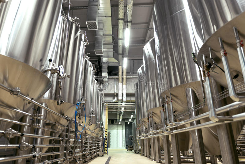 Big brewery full of special equipment. Product place. Big brewery full of special equipment being made for making beer stock photo