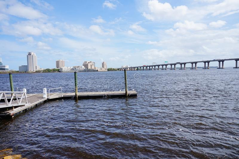 Jacksonville downtown bridge and dock. A big bridge and boat dock taken in Jacksonville, florida royalty free stock photography