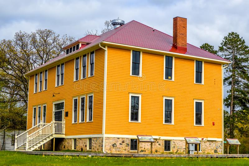 Big Bright Yellow Colonial Style House stock photography