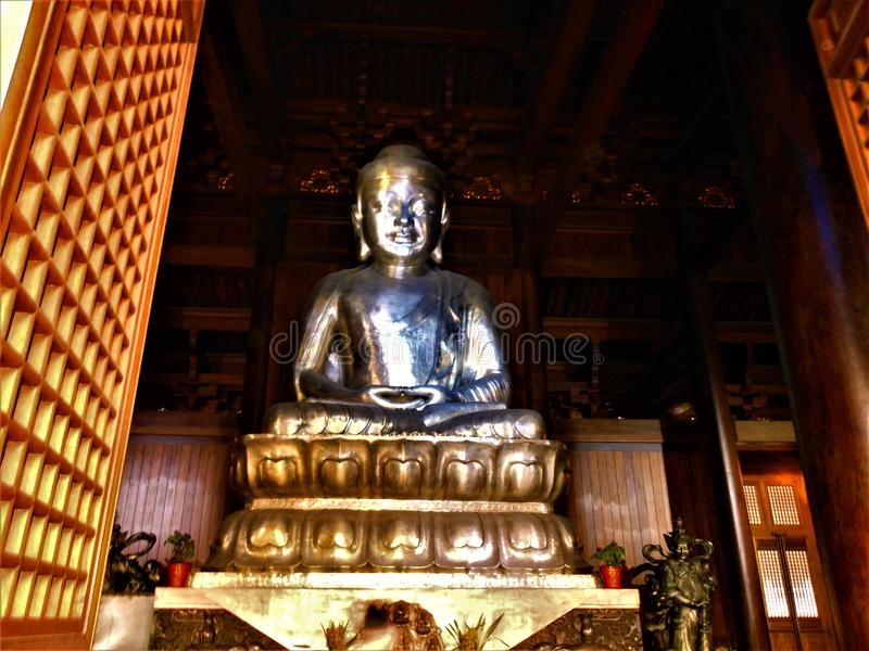 Big Buddha in a Chinese temple. Art, tradition and religion royalty free stock photography
