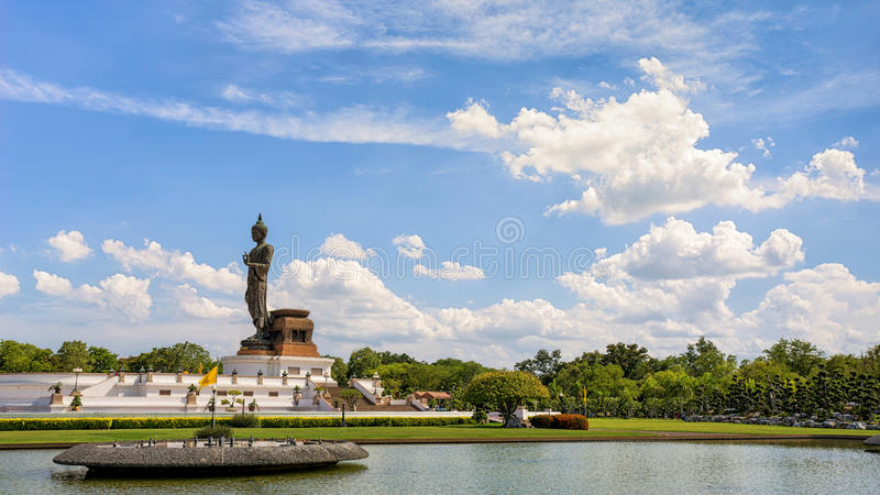 Big Buddha statue at phutthamonthon, Nakhon Pathom, Thailand. On beautiful clouds and blue sky background stock photography