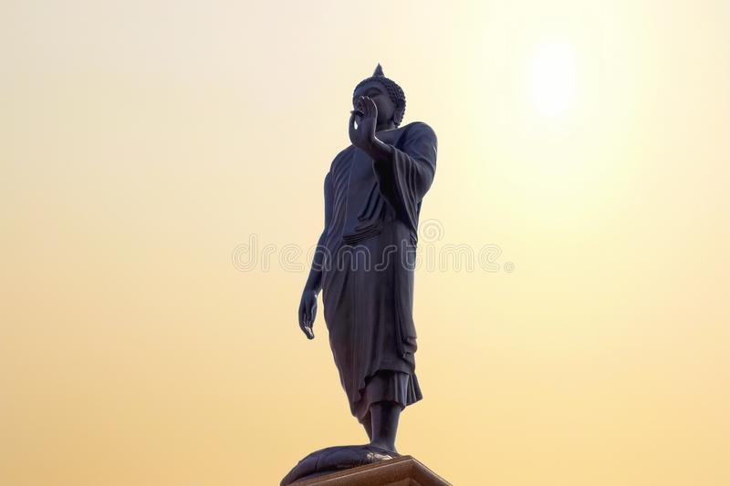 Big buddha statue standing on sun sky at temple royalty free stock photos