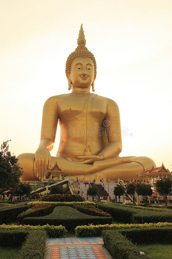 Big Buddha in temple at the sunset. royalty free stock image