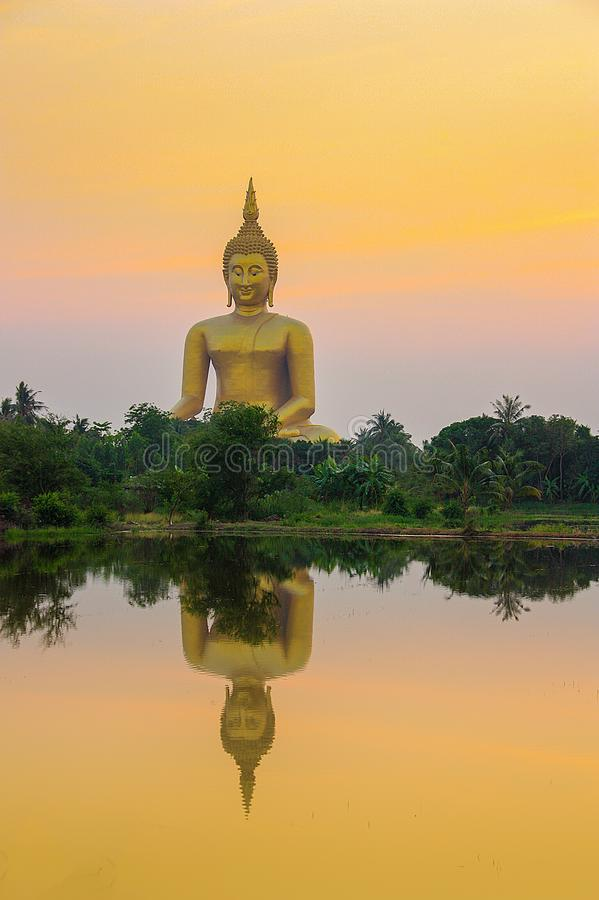 Big Buddha in temple at the sunset. stock image