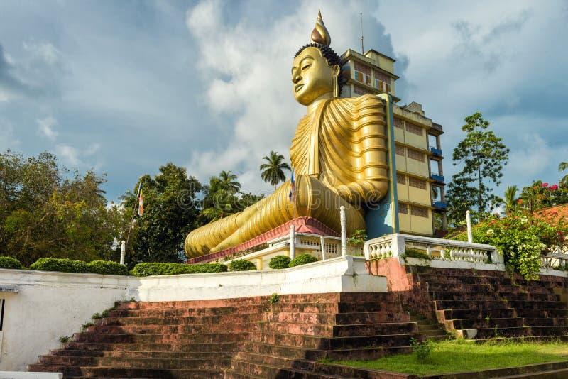 Big Buddha in the town of Dickwella, Sri Lanka. Big Buddha in the Wewurukannala Vihara old temple in the town of Dickwella, Sri Lanka. A 50m-high seated Buddha stock image