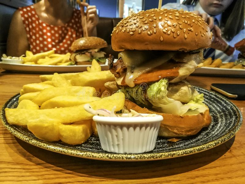 Big Burger Meal. A typical British pub lunch meal. Burger, chips and coleslaw royalty free stock images