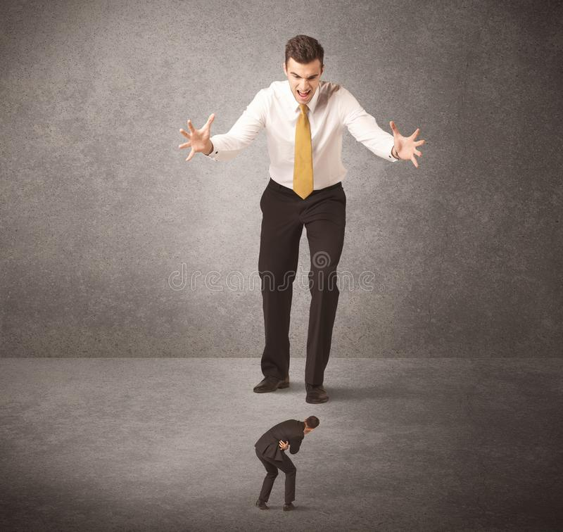 Big business man looking at small worker. Concept on background royalty free stock images
