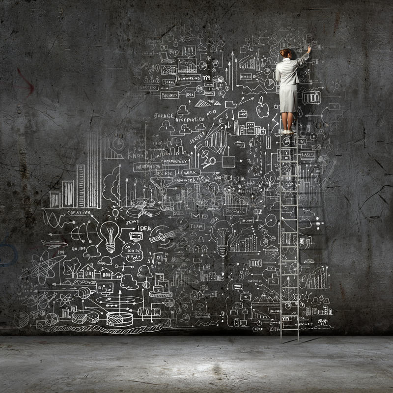 Big business plan. Rear view of businesswoman standing on ladder and drawing business sketch on wall royalty free stock image