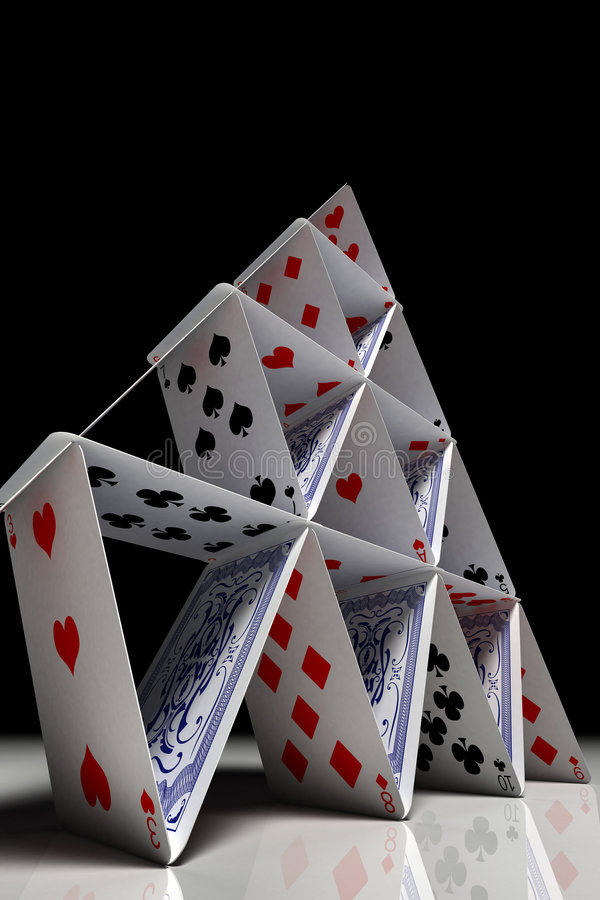 Big card house. View from the bottom up to the top of a house of cards royalty free stock photography