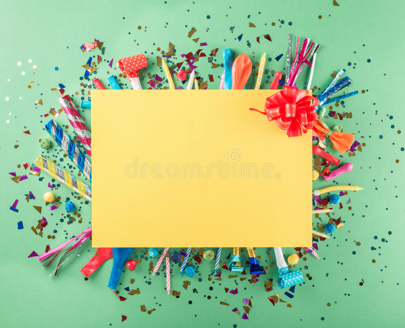 Big card with party confetti, balloons, streamers, noisemakers a royalty free stock photography