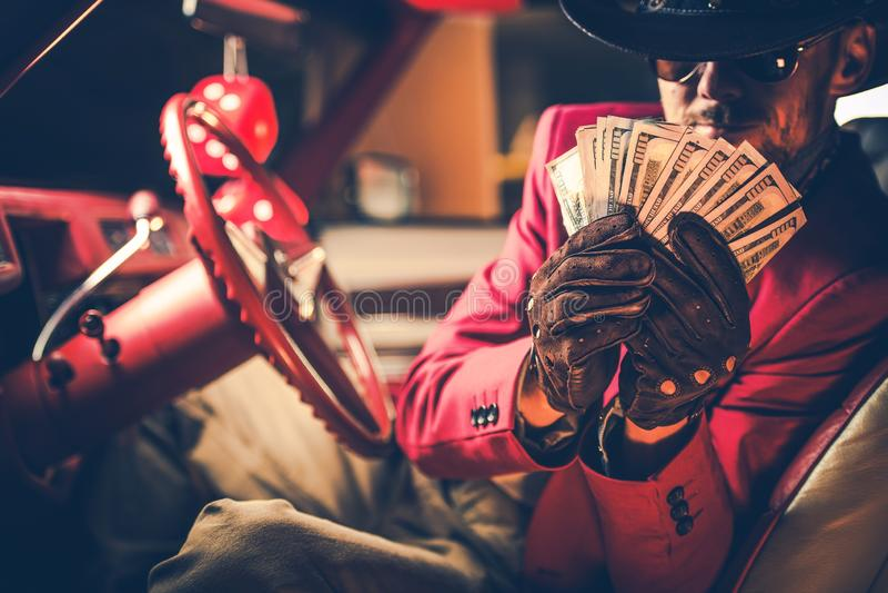 Big Casino Cowboy Winner. Happy Caucasian Men with Hundreds of Dollars in Hands. Gambling Concept stock image