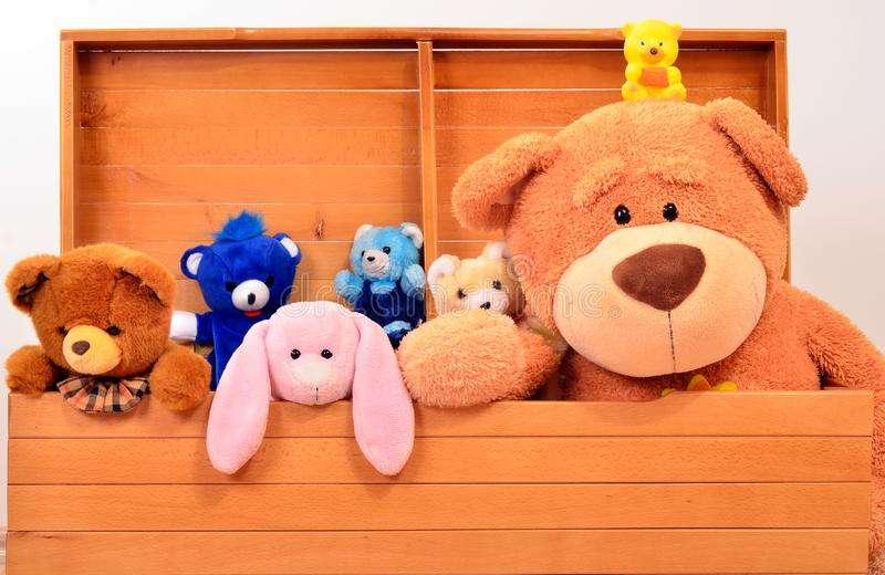 Chest with cute baby plush toys, teddies, bunnies. royalty free stock photos