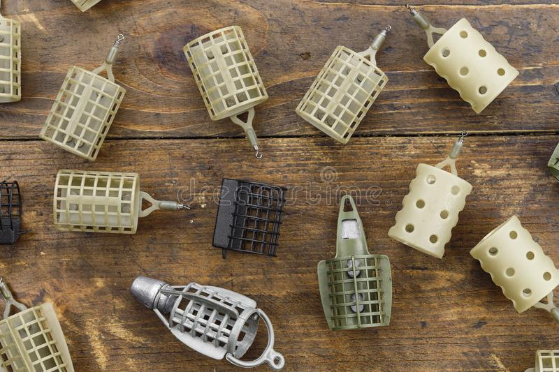 Big choice fishing feeder. Feeding troughs for fishing. Top view stock photography