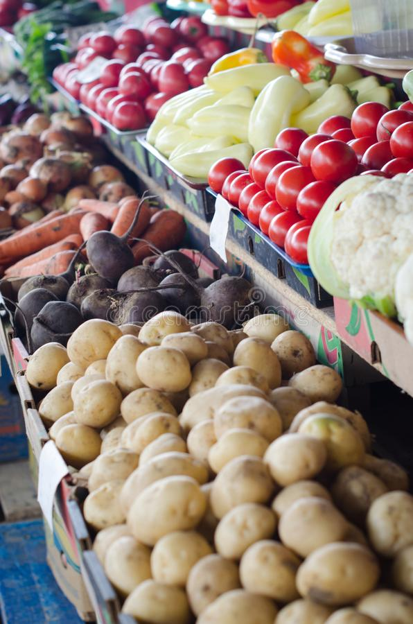 Big choice of fresh fruits and vegetables on market counter royalty free stock image