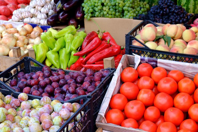 Big choice of fresh fruits and vegetables on market counter stock image