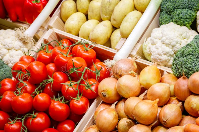 Big choice of fresh fruits and vegetables on market counter stock images