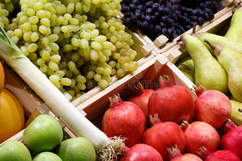 Big choice of fresh fruits and vegetables on market counter. royalty free stock photo