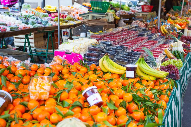 Big choice of fresh fruits and vegetables on market counter royalty free stock photo