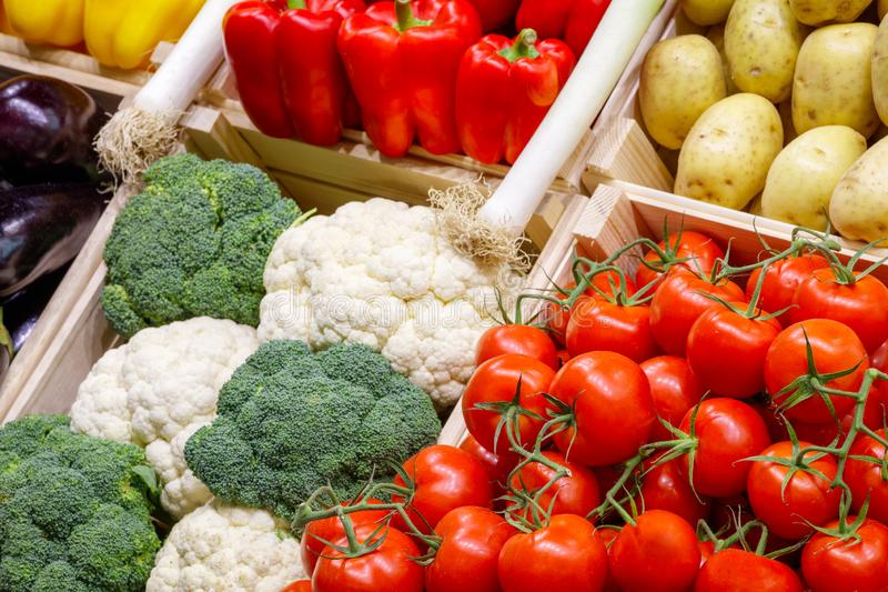Big choice of fresh vegetables on market counter royalty free stock photography