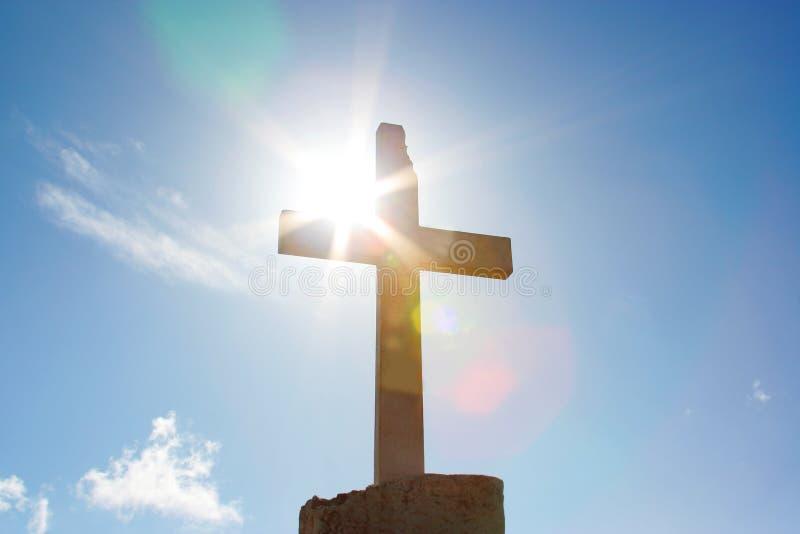 Big christian cross with sun light stock images