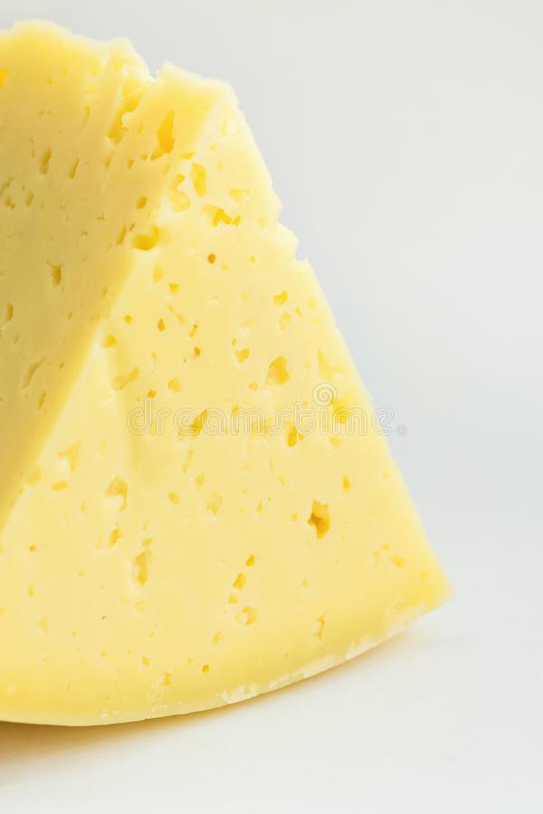 Big Chunk Wedge of Alpine Creamy Appetizing Light Yellow Tilsit Cheese on White Background. Texture with Cracks and Holes stock photography