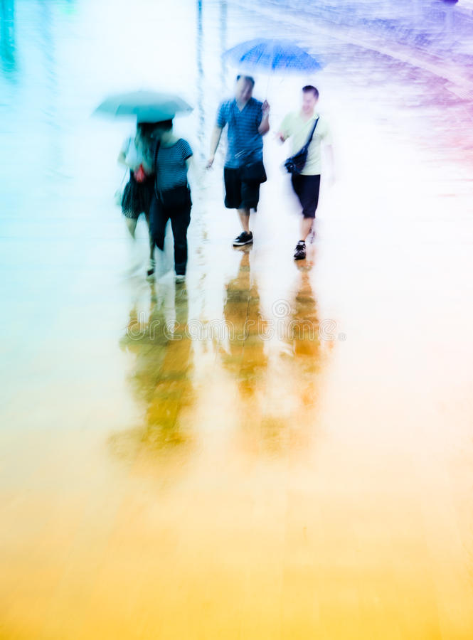 Big city people walk on road. In rainy day, blured motion abstract background stock photography