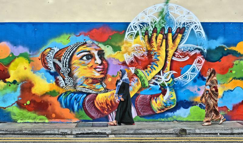 Big city street with indian woman in colorful little india District in asian metropolis Singapore stock images