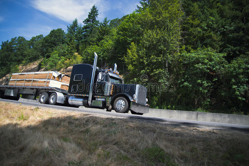 Big Classic Rig Semi Truck Carry Lumber On Flat Bed