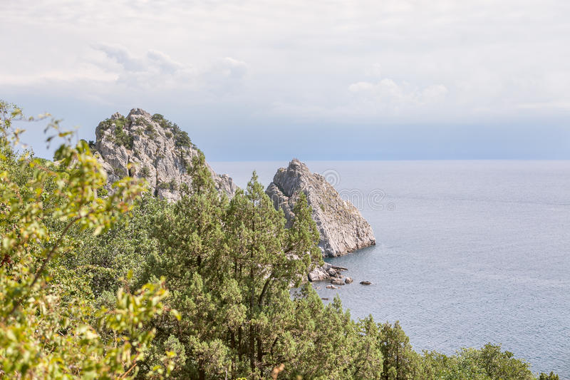 Big cliff in the sea. Famous Crimean rock Diva in Simeiz town stock photography