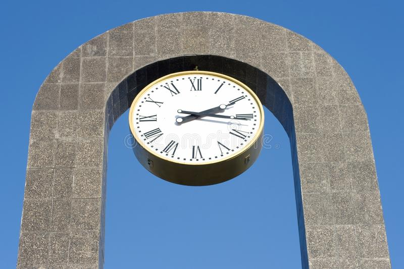 Big clock. Big classic clock under arc stock images