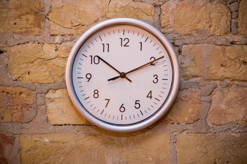 Big clock on the brick wall royalty free stock images