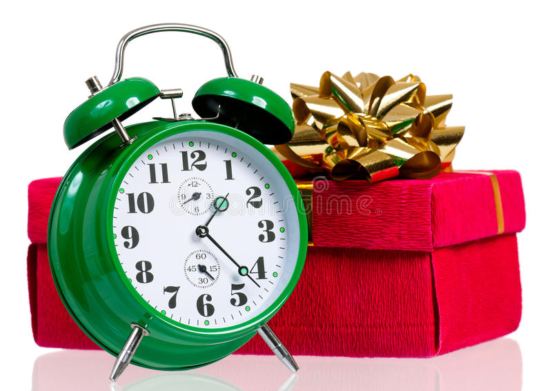 Big clock. Big green alarm clock with gift box, isolated on white background royalty free stock photography