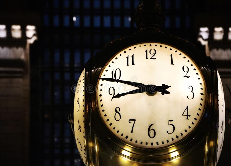 Big Clock in New York`s Grand Central Station. A big, illuminated clock face showing the time in Grand Central Station stock image