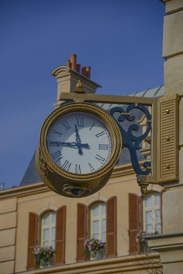 A Big Clock in the Parisian neighborhood into the Disney Studios , Paris stock photography