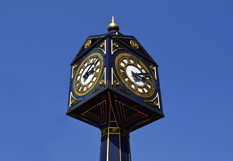 Big clock in Walsall on sunny day . Big clock on the blue sky in UK. Big clock in Walsall on sunny day . Big clock on the blue sky in United Kingdom stock photo