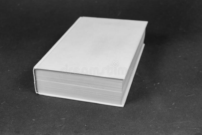 Big closed white hardcover book. Blank white cover stock photos