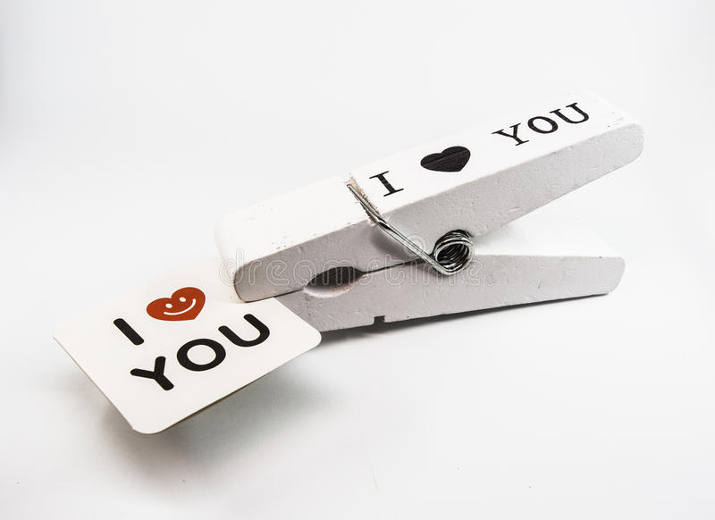 Big Clothespin with a card, I love you. Very Big Clothespin with a card, I love you royalty free stock photography