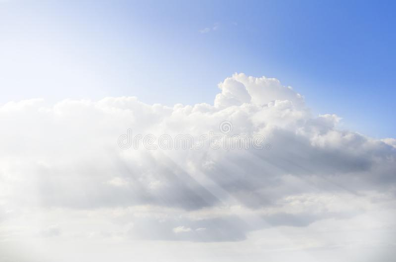 Big cloud on a background of blue sky over the sea, with sunrays, Athens, Greece royalty free stock image