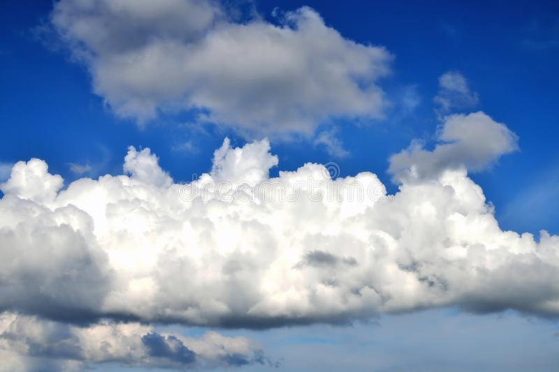 Big cloud in the blue sky. Clouse up stock photography