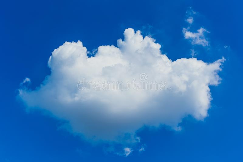 Big cloud on blue sky. Big white cloud isolated on blue sky royalty free stock images