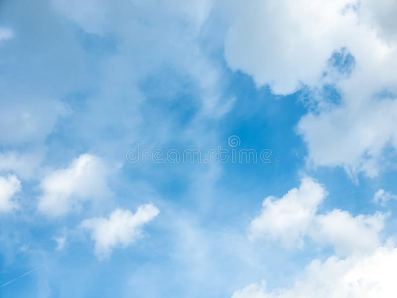Big cloud floating in blue sky with copy space. Water droplets and ice crystals gathered together into clumps. Floating in the azure atmosphere royalty free stock photography