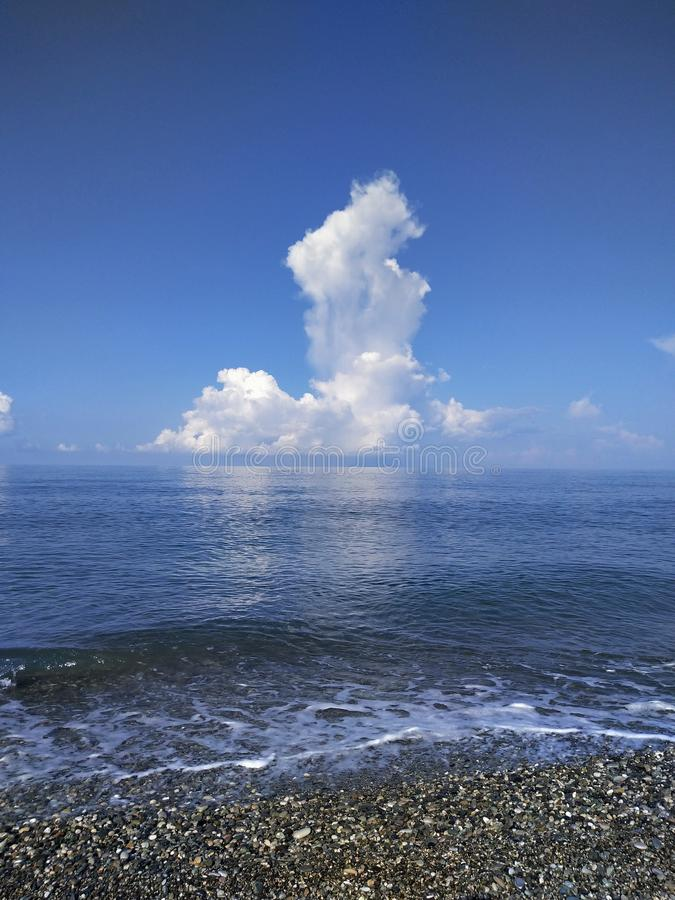 Big cloud over the horizon on the Black Sea. Big cloud  the horizon on the black sea, water, blue, transparent, sky, skyline, white, pebble, wave stock photography