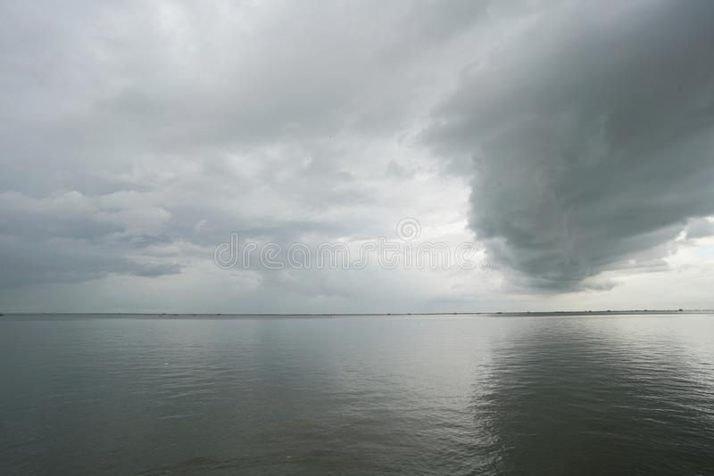 Big cloud in the sky over the sea royalty free stock photo