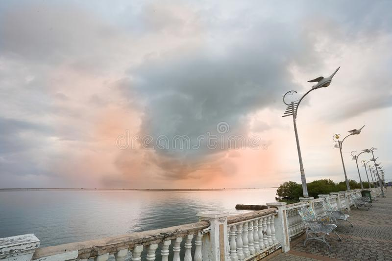Big cloud in the sky over the sea. In sunset time stock images