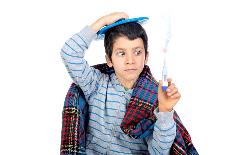 Big cold. Young boy with a cold wrapped in a blanket with a thermometer royalty free stock photography