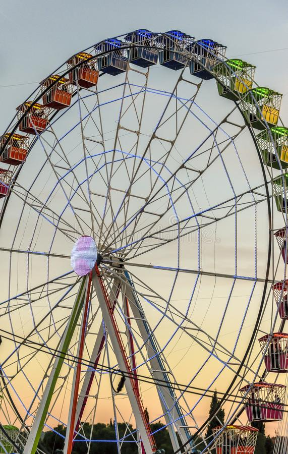 Big color wheel at a fairground. At sunset stock photo