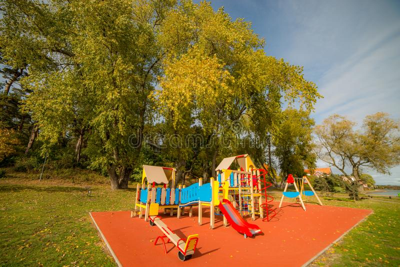 A big colorful children playground equipment. In fall season royalty free stock image