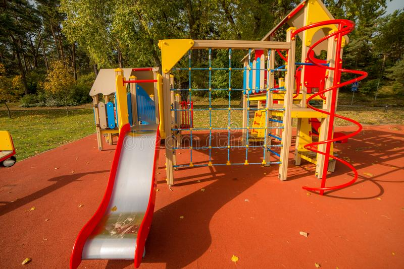 A big colorful children playground equipment. In fall season stock images