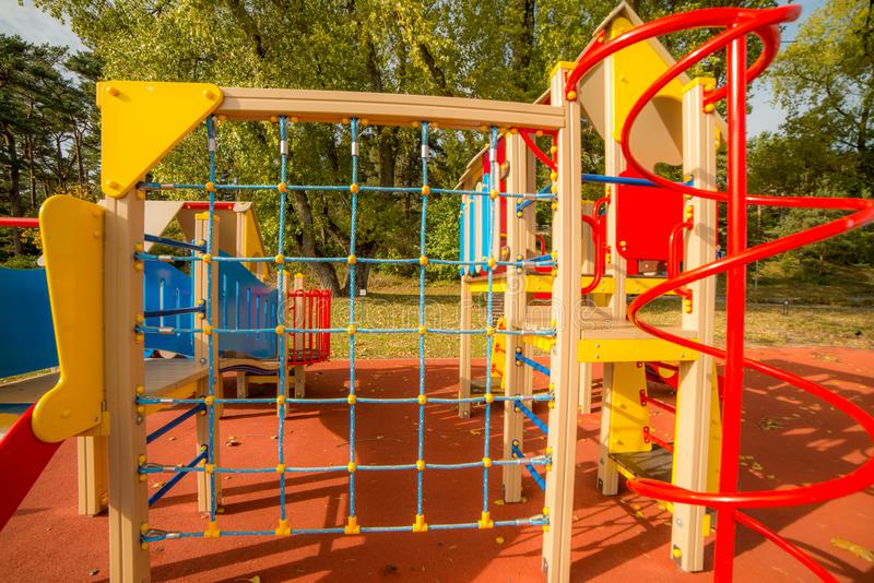A big colorful children playground equipment. In fall season stock photos